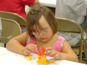 Little Girl Working on a Craft